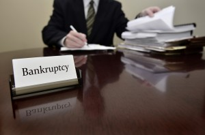 Bankruptcy attorney or accountant sitting at desk with files and