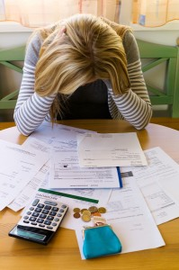 a woman with unpaid bills has many debts. unemployment and perso